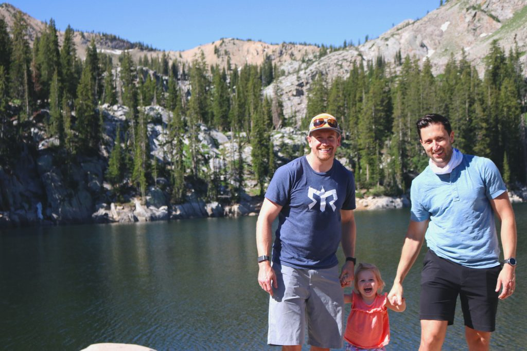 Two dads with daughter at Lake Mary in Big Cottonwood Canyon